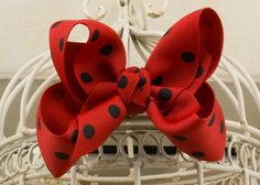 Handcrafted Polka Dot Boutique Bow. Red hair bow with black dots.