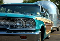 1963 Ford Galaxie Country Squire Station Wagon pulling an Airstream trailer.