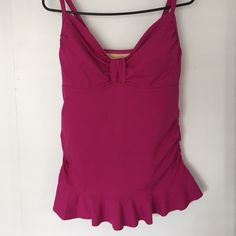 Lands End tankini swimsuit Top This is a never worn magenta colored tankini swimsuit top. It is so flattering with cute bodice and rouching on the sides! It is so well made with half inch adjustable straps. Fabric is luxurious 80% Nylon and 20?% Spandex for a perfect fit! Lands' End  Tops