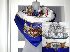 Length: 34.5 Inches; Width: 34.5 Inches  Description  This is a rare scarf with nautical novelty print in very deep royal blue, gold and red colors. The scarf features sail ships, various navigation symbols and insignia. In the center there is a royal coat of arms depicting a crowned lion and Pegasus - a mythical winged divine horse. The scarf is made of silky polyester satin, and is in excellent condition. It will certainly make a great gift or make a beautiful addition to your collection… Royal Blue And Gold, Blue Gold, Red And White, White Gold, Organza Bridal, Square Art, Designer Scarves, Purple Lilac, Japanese Prints