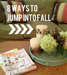 Create pretty Fall vignettes for your coffee table. Smell the Season with scented pumpkin spice candles.