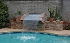 inground pool kit and waterfalls Sloped Backyard, Backyard Pool Landscaping, Patio, Pool Fountain, Waterfall Fountain, Swimming Pool Waterfall, Swimming Pools, Simple Pool, My Pool