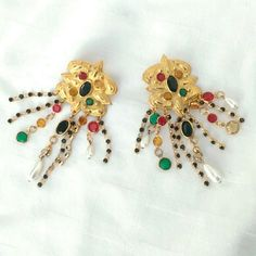 """Sorrelli Vintage Multicolored Oversized Earrings These 1980s Sorrelli earrings are outstanding! With multicolored ?round and navette?rhinestones, and pearls all prong set on gold-tone metal.The tops of earrings are 1.4"""" x 1.75"""" in a 3 D design with lots of prong-set rhinestones in a round design cluster and?multi-strands?of colored rhinestone and pearl dangles. The earrings from top to bottom are approximately?4.5"""" long. These ?earrings are signed Sorrelli and in excellent condition with…"""