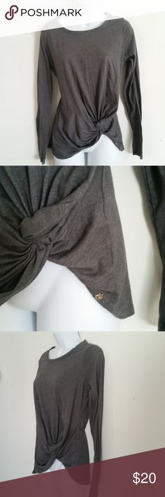 """Fabletics Top Faux Wrap Knotted Medium Fabletics Womens Shirt Medium Gray Faux Wrap Knotted RN 134638 Athletic Running  Bust (laying flat armpit to armpit): 20"""" Shoulder to hem: 25""""  Fabric Content: 50% Cotton; 50% Polyester  Trusted Seller. Fast shipping.  Please check out my other listings. Items being added daily. Thanks for stopping in!  Posh By Design Fabletics Tops Tees - Long Sleeve"""