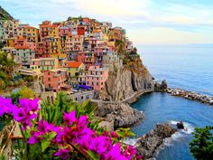 Manarola, Italy is one of the famed Cinque Terre towns, filled with an array of vibrant rainbow-colored homes carved right into an impenetrable wall of stone along the Mediterranean coast. Read more: http://www.tripstodiscover.com/27-of-the-most-beautiful-small-towns-to-visit-in-europe/#ixzz3NaMaJtns