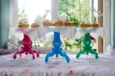 Wonderfully easy to assemble in a matter of moments and available in a vibrant pink, blue or green.     The cake tier is separate from the stand so it easily slots into your cake tin to provide a much-needed extra shelf – Those beautifully decorated cakes and muffins will never be flattened again.      Simply lift the shelf straight out of the tin and slot the pedestals into the tier notches and hey presto… a delightful cake stand, ready to go. Cake Stands, Decorated Cakes, Tiered Cakes, Separate, Pink Blue, Slot, Cake Decorating, Muffins, Shelf