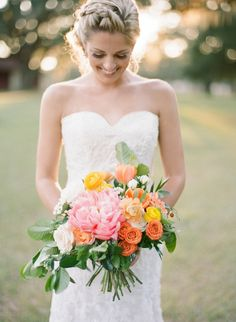 Florida Bride in Sweetheart Wedding Dress with Orange, Yellow and Pink Wedding Bouquet   Emily Katharine Photography on @marrymetampabay via @aislesociety