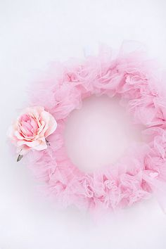 Pretty pink wreath/ This is so cute to put on my daughters bedroom door.- cute for maybe the front door- use a boa for a quick make-shift wreath and add flower barrette to it
