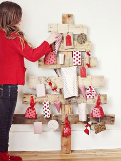 Want to lean up a bunch of pallet wood in a corner of your house and then tack all of your presents to it? Well, fine then. I won't stop you.