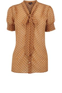 This polka dot blouse has a pussy bow finish to the front and a slightly cuffed sleeve. Simply buttoning down the front, this is perfect for office wear.
