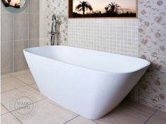 This Beautiful polished Finish White Catherine Bath is a contemporary freestanding bathtub inspired by modern and geometric lines. Ideal for the modern apartment, simple and classic form, an ideal. This elegant modern bath comes w Bathroom Bath, Modern Apartment, Free Standing Bath, Modern Baths, Stone Basin, Bath Spa, White, Clawfoot Bathtub, Luxury Bath