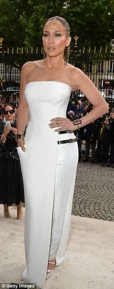 Jennifer Lopez wears gown with sparkly trouser leg to Versace event #dailymail