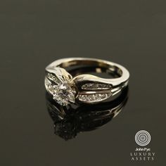 14ct White Gold Solitaire Ring Comprising a Round cut Diamond