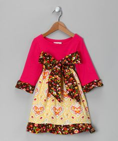 Vibrant flowers bloom upon the ruffled cuffs and hem of this pretty, zulily-exclusive dress, matching the tie belt and giving a home to the butterflies and ladybugs dancing upon its skirt. Made from soft cotton and sporting a pullover design, little darlings won't want to stop waltzing while wearing this favorite dress.
