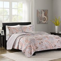 Add a pop of color with the Layla Coverlet Mini Set by Home Essence.  The grey coverlet features a soft pink paisley design on the bottom portion, and reverses to a coordinating print.  Two matching shams are included in this set.
