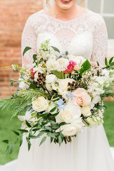 Specialties Florals and Events cascading bridal bouquet with cream flowers and greenery photo. #wedding #flowers #brides #floral #women's  #weddingideas #flowerarrangements #bridesmaid