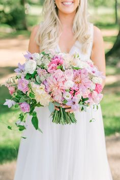 Pink, purple, and cream dahlias were married with lavender clematis for this breathtaking Blue Jasmine clutch.
