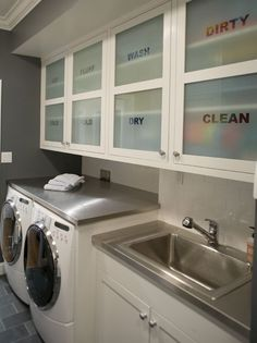 Awesome frosted glass doors...keeps that laundry theme going, but still hides the clutter