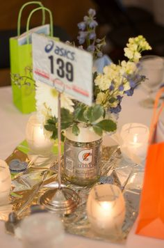 Another view of the centrepieces on the guests tables. #running #wedding #runningwedding