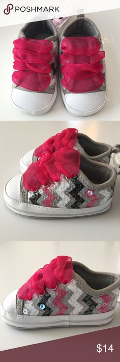 🌸HP🌸 Sequin Baby Tennis Shoes Adorable Pink ribbon laces with zig zag print topped in sequins. Soft padded insoles and canvas bottoms. Sz. 4  9-12 months NWT 🌸HP🌸 Chosen 1/1/17 by 🌸Marlana🌸@marlanap4kids Everything kids🎉 Stepping Stones Shoes Baby & Walker