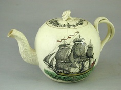 English creamware teapot transfer printed with a ship and compass