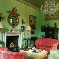 soft apple green walls haven't been painted for more than eighty years.  Chinese lacquered cabinet and convex mirror with elaborate dragon and pink sofas came with the Georgian country house.