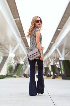 Flare Jeans Dark Wash: Cassandra De La Vega is wearing a pair of flare jeans from H&M