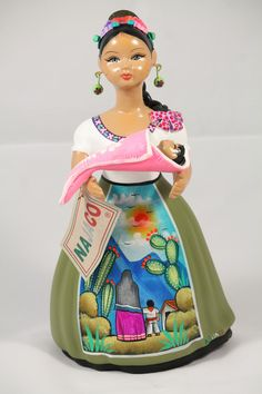 Authentic Handmade NAJACO Lupita w a baby, Mexican Figurine, Lime Green Skirt. POCHTECA imports direct from Mexico from original artist handmade/ painted Collectible Home Decor Mexican Folk Art Ceramic Clay Ceramic Clay, Ceramic Bowls, Baby Olive, Handmade Paint, Holding Baby, Ceramic Figures, Mexican Folk Art, Lime, Pottery