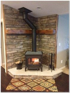 Wood Stove Corner Hearth Ideas- why can this be so close to the corner? I like the wooden wall rail