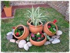 Flower pots and rocks make a cute addition to your outside landscaping. diy garden landscaping 15 One-Day Garden Projects Anyone Can Do Garden Yard Ideas, Simple Backyard Ideas, Front Yard Ideas, Diy Garden Ideas On A Budget, Creative Garden Ideas, Cheap Garden Ideas, Small Garden Ideas Low Maintenance, Tiny Garden Ideas, Tire Garden
