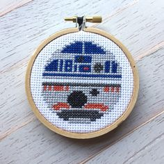 "This pattern features R2D2 and BB8 in one full circle piece! Skill Level: Beginner to intermediate DIY kit includes pattern, instructions, image, color list, DMC threads, aida 14 count fabric, 3"" wood"
