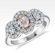Blue Nile Fancy Pink Three stone Diamond Halo Ring in Platinum and 18kt Rose Gold
