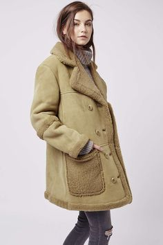 All your coat prayers have been answered with this real shearling coat in a boxy 70s silhouette. #Topshop
