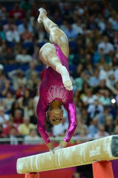 US gymnast Gabby Douglas performs on the beam during the artistic gymnastics women's individual all-around final at the 02 North Greenwich Arena in London on August 2, 2012 during the London 2012 Olympic Games. Douglas won the event.