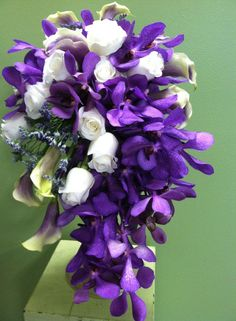 Contemporary Purple Orchid, White Rose and White/Purple Calla Lily  Design By Beth Parker www.earlesflowers.com  Earle's Loveland Floral and Gifts   1421 N. Denver Ave Loveland, CO 80538  970.667.7550