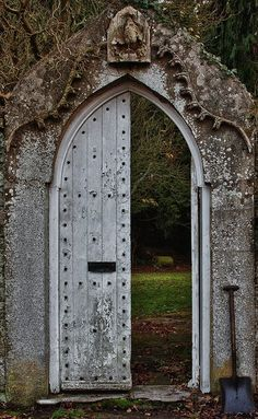 wooden arched gateway leading into a garden