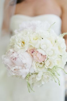 I spy.... a Peony and Ranunculus ... Roses? It's a totally gorgeous bouquet by FH Weddings! See the wedding on SMP:  http://www.StyleMePretty.com/southeast-weddings/2013/11/21/tampa-bay-wedding-from-debra-eby-photography/ Debra Eby Photography
