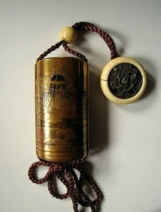 Copper Inro (box) and Ivory netsuke (button)
