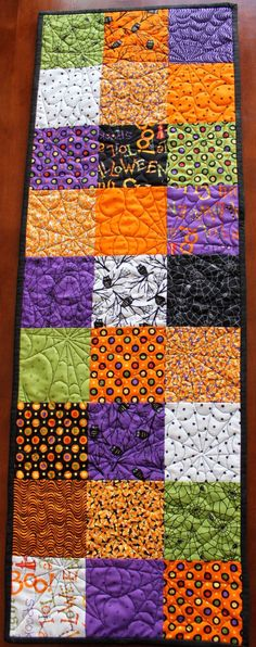 Quilted Halloween Table Runner--love the spider web quilting on it: