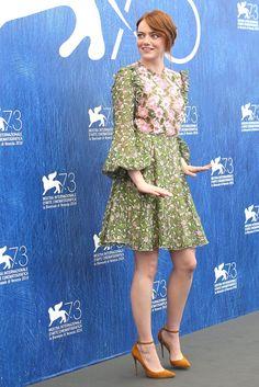 """Funny faces: Emma Stone in Giambattista Valli attending the photocall of her new movie """"La La Land"""" at Venice Film Festival."""