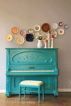 love the way the plates are displayed on the wall and the turquoise piano