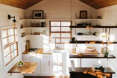 Kitchen with Suspended Shelving - Monocle by Wind River Tiny Homes