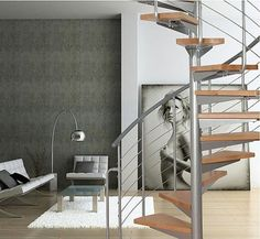 Spiral staircase (metal frame and wooden steps) - ATRIUM SYSTEM - ArchiExpo