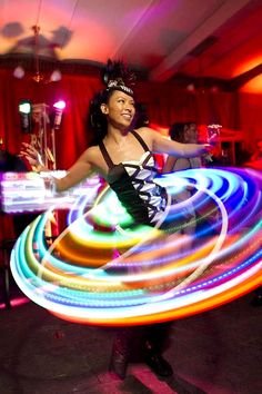 Nicole Wong of Cherry Hoops lights up the night at ISES Gala 2012 at the Old U.S. Mint in San Francisco, California, USA. Photo by BayAreaEventPhotography.com. A Hooping.org Photo of the Day.
