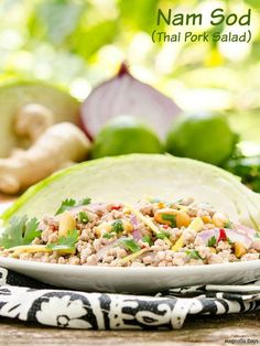 Nam Sod (Thai Pork Salad) is a healthy meal full of flavors including lime, chile, onion, ginger, peanut, and cilantro. Serve it with cabbage wedges. #SundaySupper