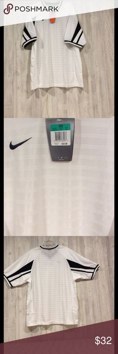 NIKE short sleeve polo. Black and white, 100 percent polyester. Nice detail in fabric. Fabric lightweight great for golf or soccer. No flaws or defects. Nike Shirts Polos