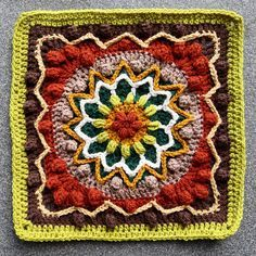 Inspired by the beautiful cherry blossoms I saw in Japan, Rebirth is a crochet square featuring a central floral and starburst pattern with surrounding popcorns.
