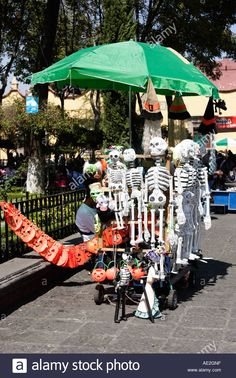 Vending cart with paper mache skeletons.
