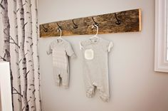A modern yet cozy, gender neutral, woodland themed nursery with fox paraphernalia as the main attraction.