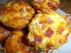 4C frozen shredded hash browns, thawed 3T melted butter 1/4 tsp each S&P 7 eggs 1/4C milk 1 1/2C shredded cheese 1C diced ham Combine the hash browns, butter, salt and pepper. Spray your muffin tin. Fill the cups about 3/4 of the way with the hashbrowns and mold the hashbrowns to the cup. Bake at 400 for 20min. Mix rest of ingredients. Reduce the temp to 350 degrees. Fill the cups almost to the top bake 20-25 minutes.